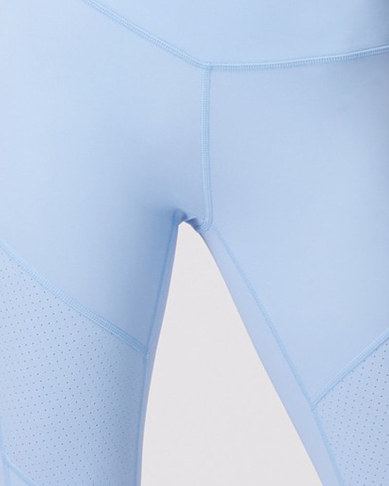 Close up of perforated fabric of l'urv nebula legging in soft blue