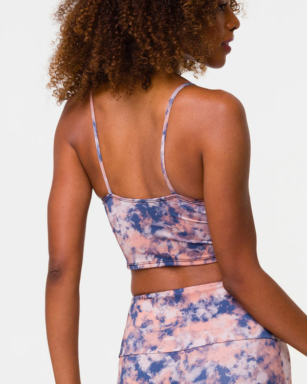 Rear view of model wearing cami belle crop in earth tie dye colour