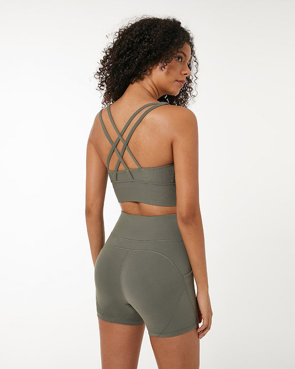 Rear view of model wearing khaki ribbed crop