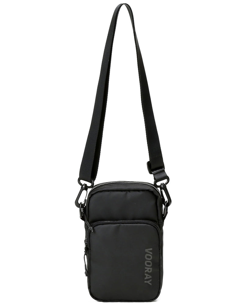Front view showing long strap on matte black core crossbody bag