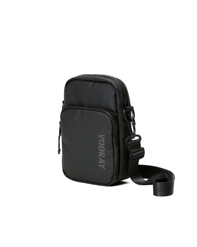 Side view of core crossbody bag in matte black