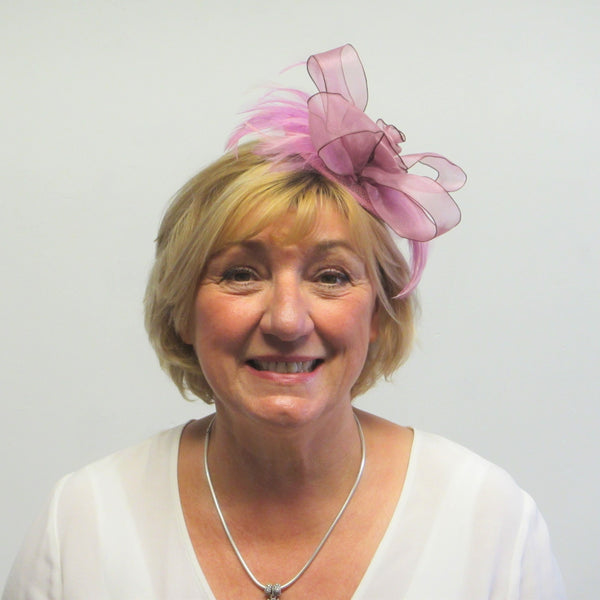 Rose bow fascinator with feathers