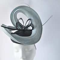 Parasisal Swirl button fascinator with Goose Biot Feathers and Spines