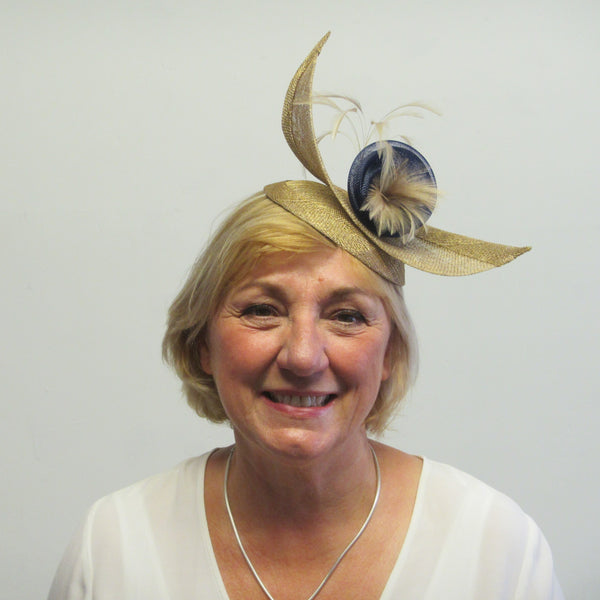 Upward curved fascinator with flower and feathers