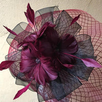 Crinoline fascinator with ribbons and feather flowers
