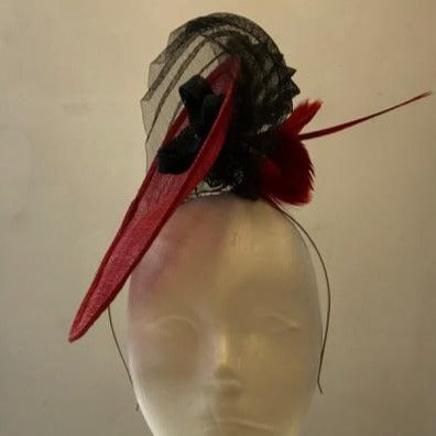 Small saucer fascinator with cinoline, feather flowers and small bow with diamante