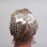 Diamante netting bow with flowers on a comb