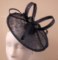 Disc with ribbons and swirl fascinator