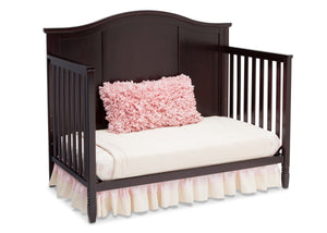 Delta Children Dark Chocolate (207) Maverick 4-in-1 Crib, angled conversion to daybed, a5a
