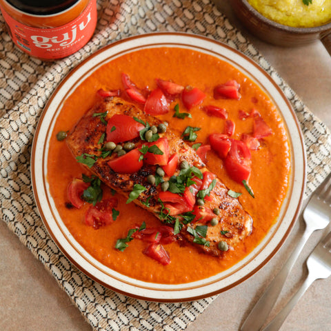 Red pepper sauce paired with mediterranean salmon for an delicious indian inspired dinner