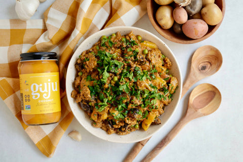 Delicious coconut indian simmer sauce with beef, potatoes, and peas