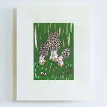 Load image into Gallery viewer, A small screenprint of three morel mushrooms on a dark green background. The print is made up of three colours, an emerald green, a light brown, and a dark brown. The print is small on the paper, with large white borders around it.