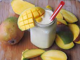 mango and coconut drink in a glass jar