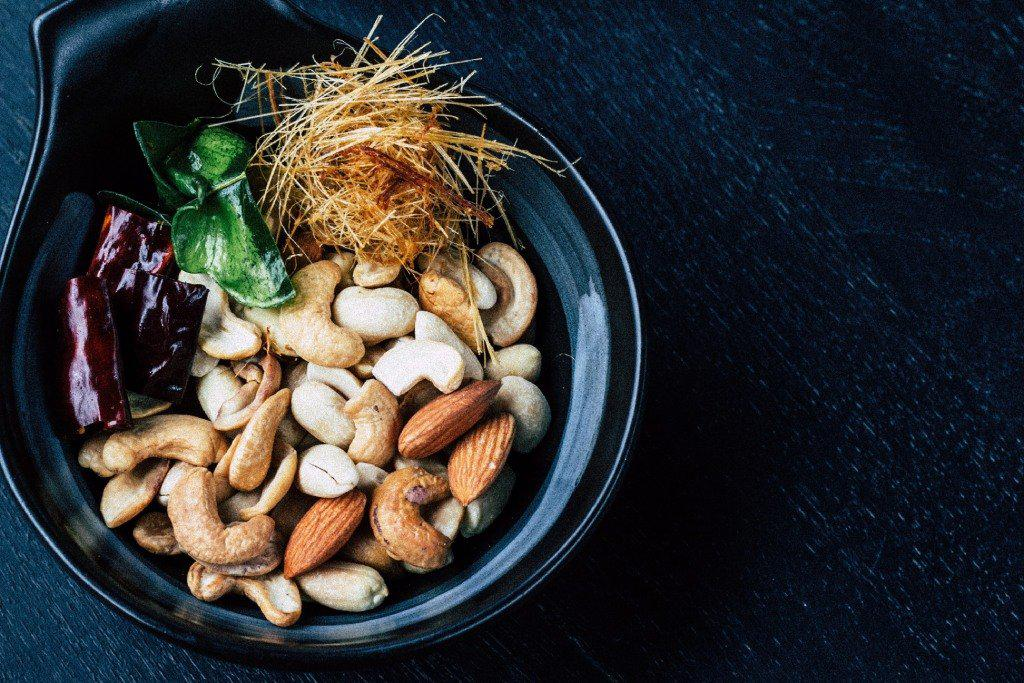 Assorted Nuts in a dark bowl