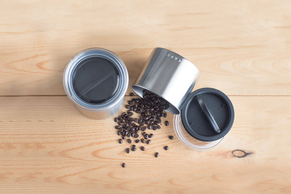 coffee canister with coffee spilling out