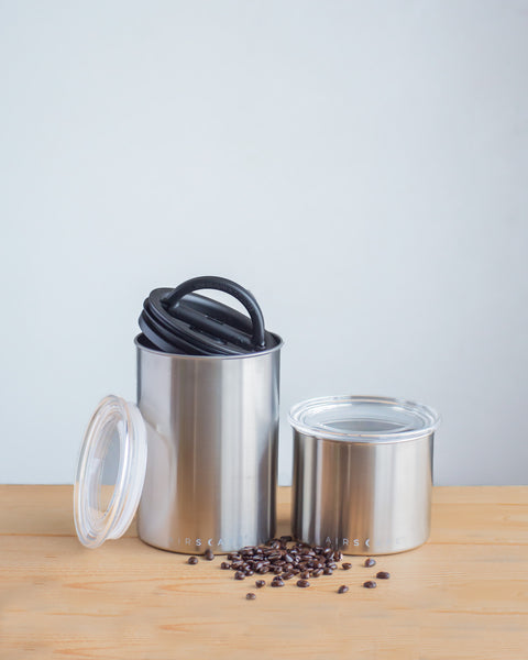 coffee canisters siting next to wall