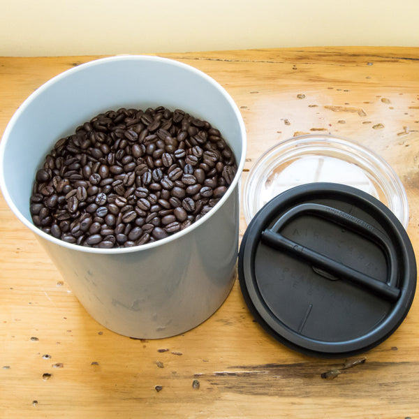 coffee canister with whole beans in it