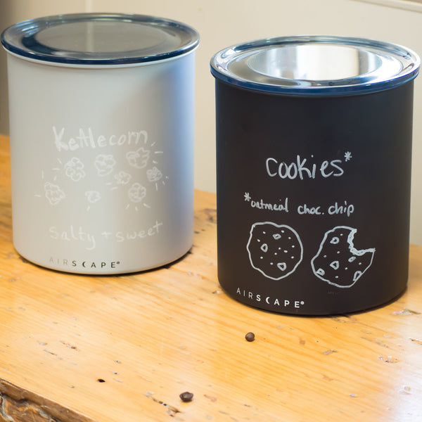 coffee canisters with writing
