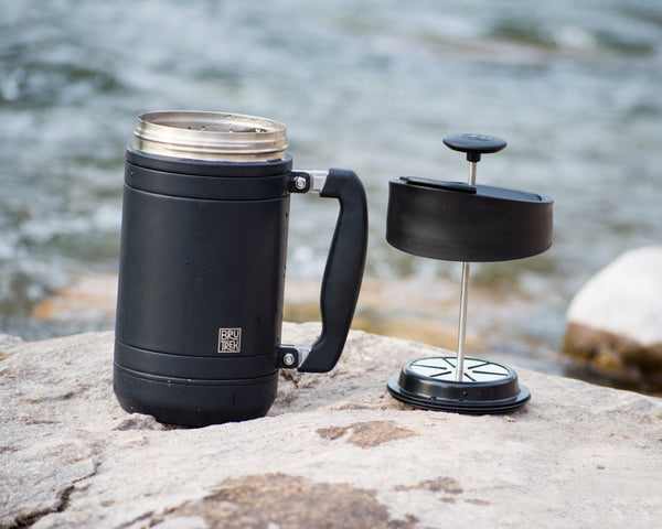 brutrek french press on river rocks outdoors in mountains