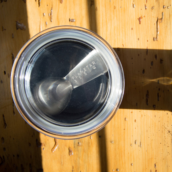 coffee scoop nested in airscape container