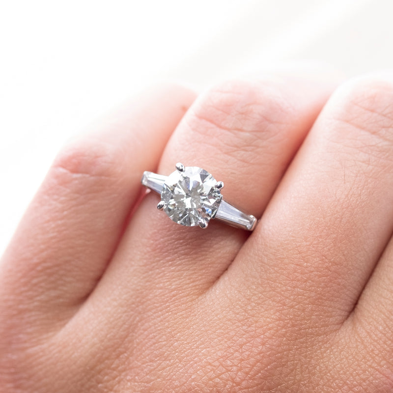 Diamond (2.28ct) Ring Flanked by Tapered Baguette Diamonds in Platinum