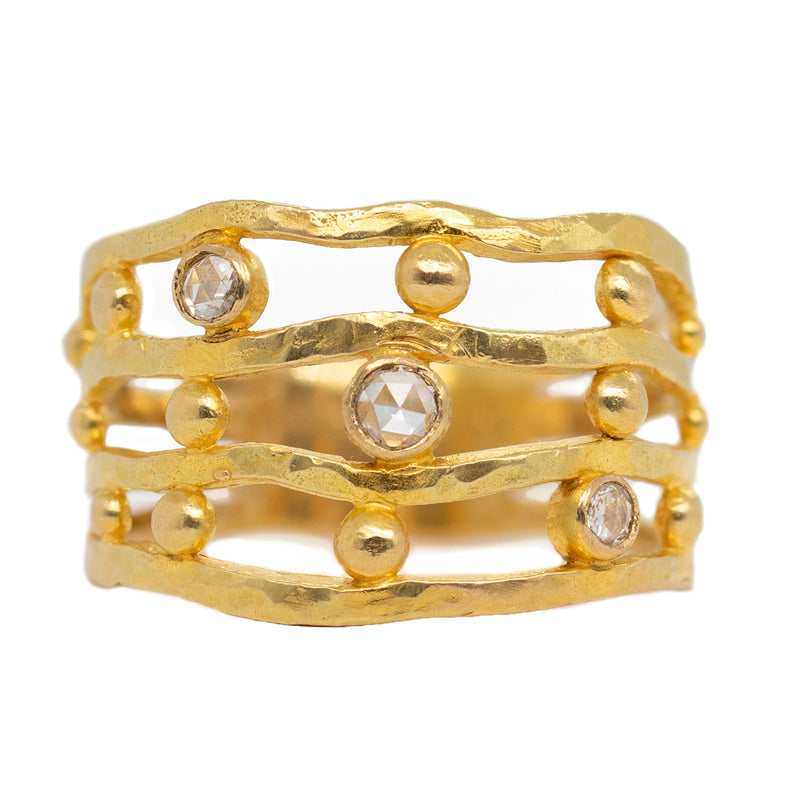18 karat yellow gold textured four-row ring featuring three rose cut diamonds 0.10ctw.