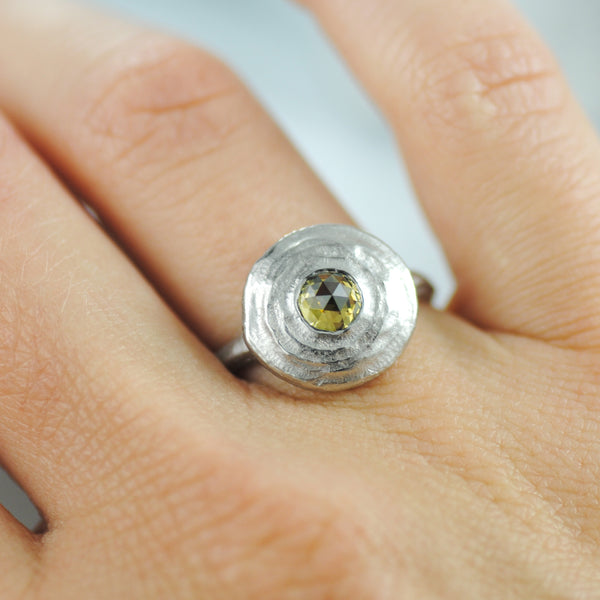 Circular Platinum Ring with a Yellow Diamond (0.62ct)