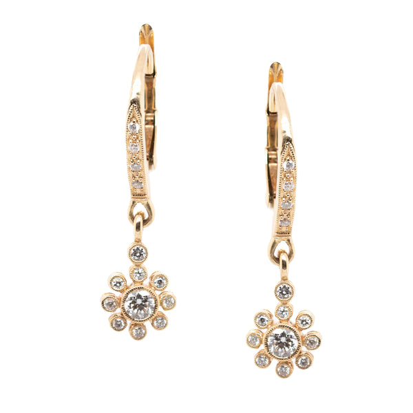 Diamond Earrings Featuring a Flower Design in Gold