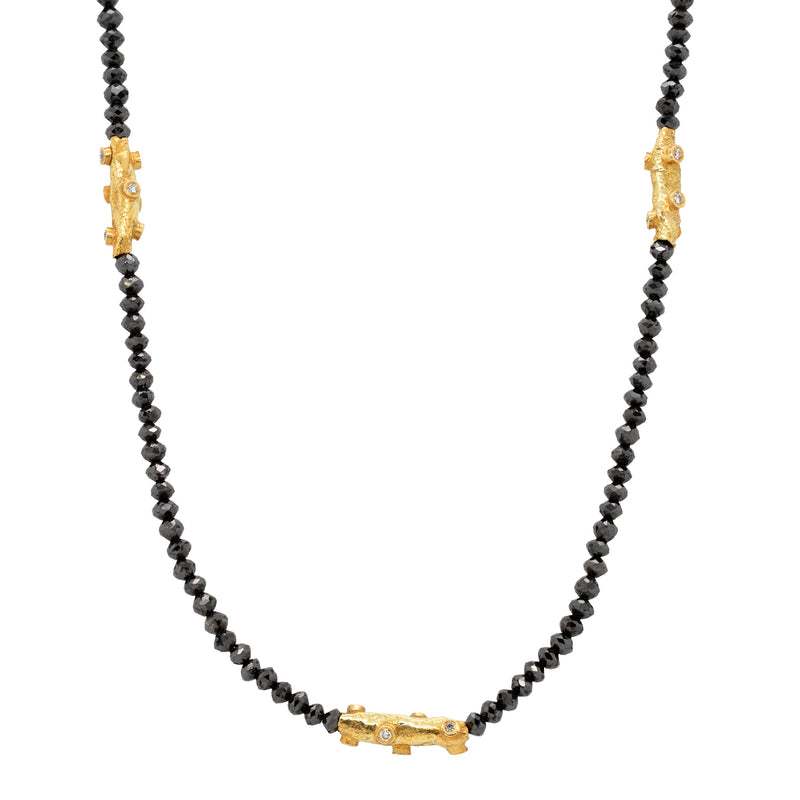 Necklace featuring black diamond beads and three yellow gold and white diamond branch accents, with an oval clasp with gold granulation details. Length of 18 inches.