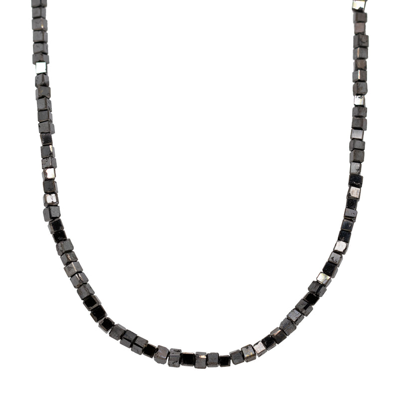 Strand necklace featuring graduated black diamond cubes with a 14 karat white gold double trigger-less lobster clasp. Length of 17.75 inches.
