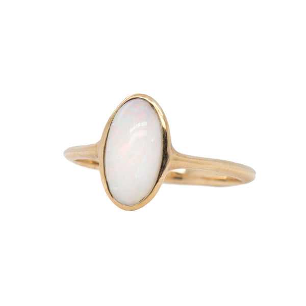 14 karat yellow gold almond shaped ring featuring a hand cut Australian opal. Finger size 6.5.