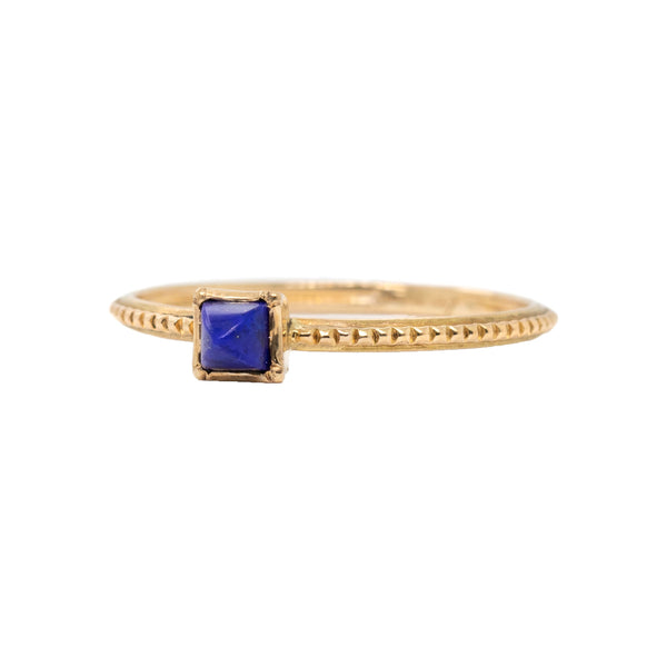 14 karat yellow gold ring in a beaded pattern featuring a 3mm pyramid lapis. Finger size 7.5.