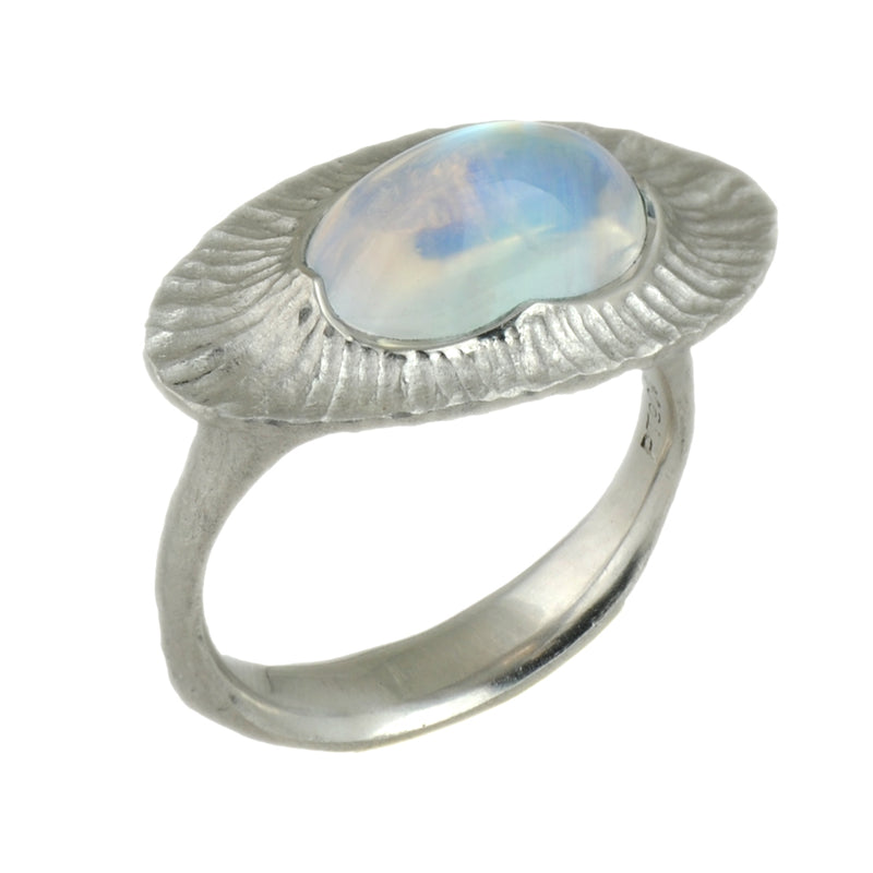 Platinum ring featuring a scalloped, textured bezel set oval Rainbow Moonstone 3.79ct, with a redwood bark textured shank, in a finger size 7.