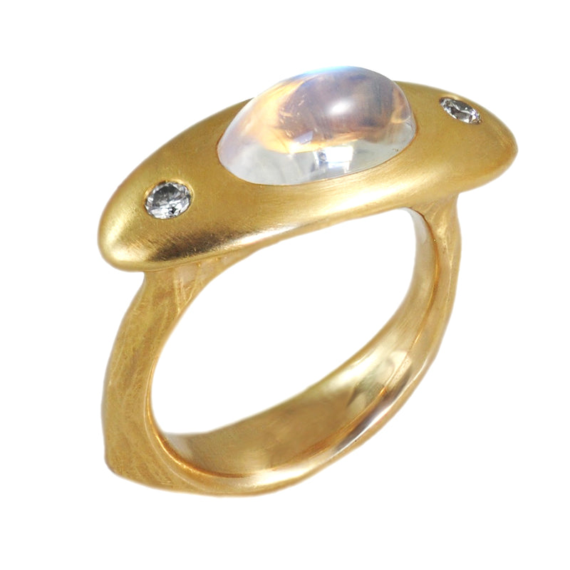Dreamy moonstone ring with the perfect mix of elegance, sophistication, and modernity. This ring was handcrafted in our workshop in gold and accented with diamonds.   Details: - 18 karat yellow gold - oval rainbow moonstone 2.74ct - accented by flush set diamonds 0.11ctw  Made by Roberta and Joel in our workshop.