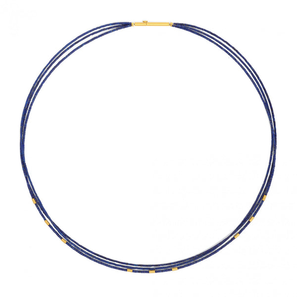 Lapis lazuli triple bead strand necklace featuring gold plated sterling silver accents.  Made in a studio 100% powered by renewable energy in Germany.
