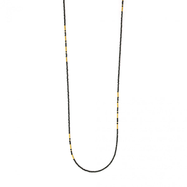 Black spinel necklace featuring gold plated sterling silver beaded accents. Length of 34 inches.