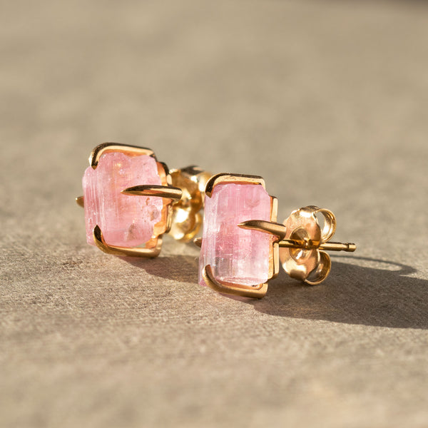 Handcrafted in our workshop.   14 karat yellow gold hand fabricated 4 prong stud earrings featuring raw, organic pink tourmalines.