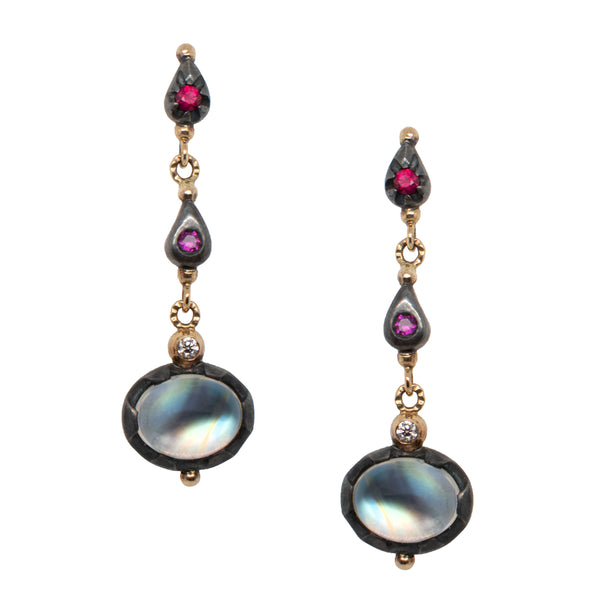Rainbow moonstone earrings with two 18 karat yellow bezel set diamonds and four rubies surrounded by oxidized silver. These stud-dangles are suspended in 18 karat yellow gold posts and studs.