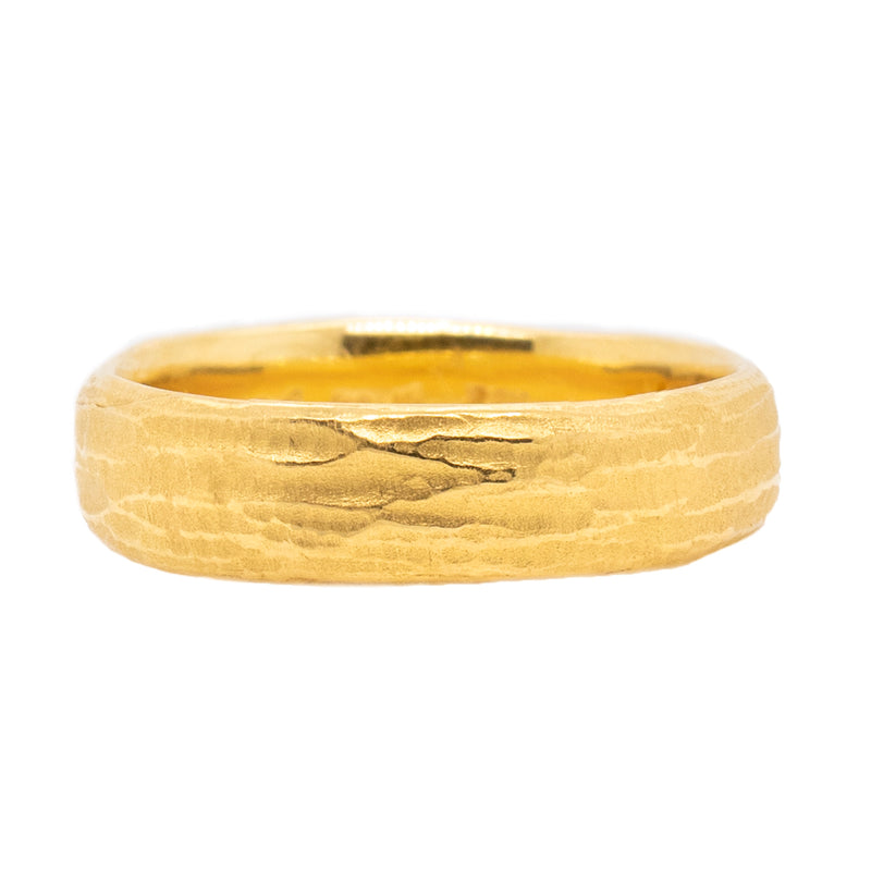 22 karat yellow gold 7mm band designed by Michael Endlich featuring redwood bark texture all the way around, in a finger size 11.25.