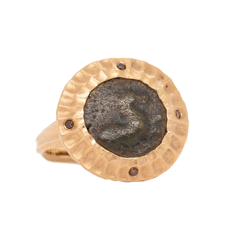 18 karat rose gold ring designed by Michael Endlich featuring a scalloped bezel set ancient Greek coin with a horse, featuring four autumnal diamonds (0.04ctw) on the cardinal points, with a redwood bark textured shank. Finger size 6.5.  Made by Joel and Roberta in our workshop.