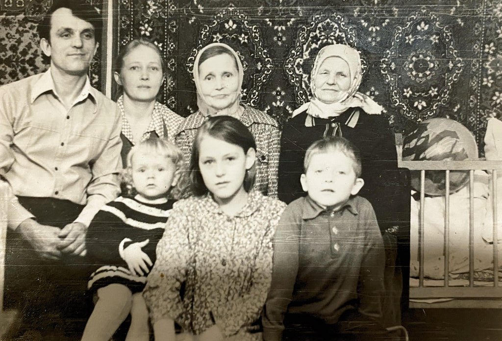 Valentina with her husband, mother, mother in law, and children