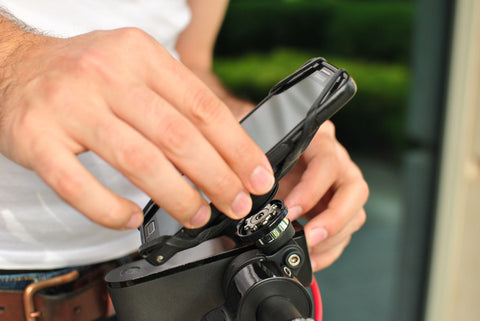Man mount a phone holder to bike