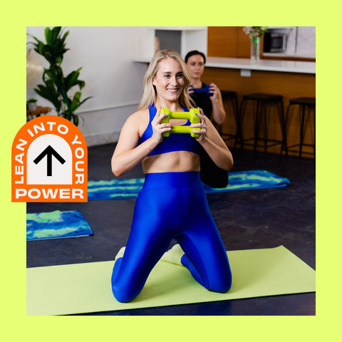 Still of Electric Collective Fitness Founder and Personal Trainer, Lilly Scott coaching modern fitness enthusiasts during a Body By Lilly Scott at-home group workout class.
