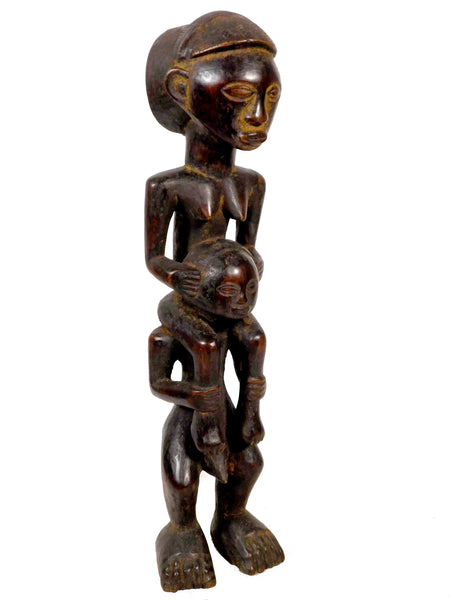 Figure of a Woman on the Shoulders of a Man, Tabwa, Zaire