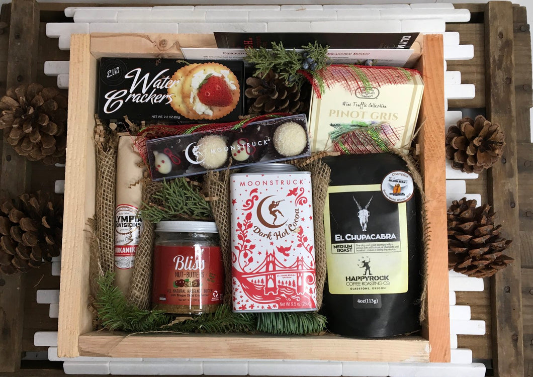 Sample box containing salami, chocolate bar, coffee beans, nut butter, wine truffles,  chocolate truffles, crackers.