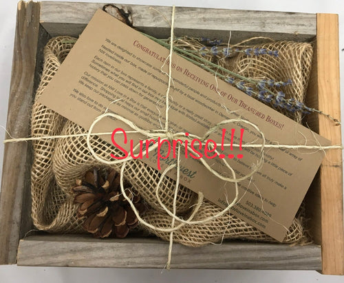 Empty box with pinecone and lavender sprig décor. NW Love-In-A-Box business general and contact information.