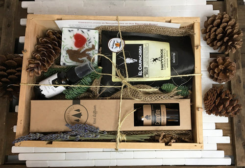 Sample box containing coffee beans, beard oil, reed diffuser, and sasquatch soap.
