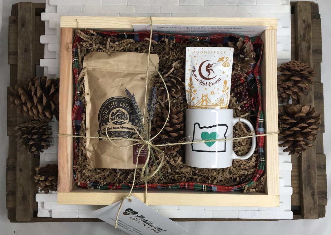 Sample box containing coffee beans, an Oregon Luv mug, and hot chocolate.