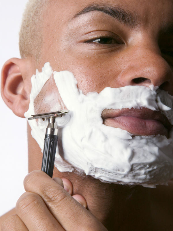 Man of color shaving