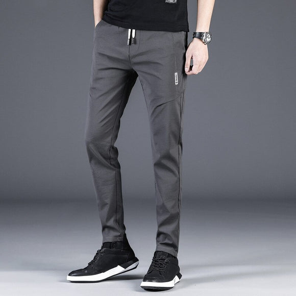 MRMT 2020 Brand Spring and Summer New Young Men's Casual Trousers Straight Pants for Male Elastic Black Thin Trousers